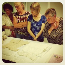Our Wor Women group behind the scenes in the costume stores at Discovery Museum.