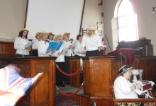 The Positive Notes choir signing in the chapel at Beamish Museum.